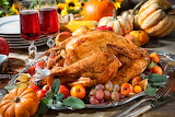 Thanksgiving day-roast turkey-vegetables-pumpkins-wine