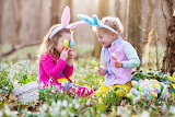 Easter! Children look for eggs in the meadow-shutterstock