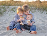 Brothers playing with shells