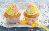 Cupcakes decorated with yellow cream and candy