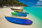Canoes-beach-ocean-boat-sand-blue-lagoon