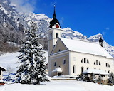 Church With Clock Tower in the Mountains