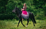 Gypsy woman with her horse