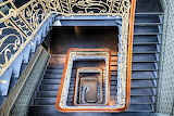 Looking down beautiful blue staircase