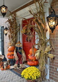 Dried cornstalk, pumpkin's topiaries, mums and a cute scarecrow