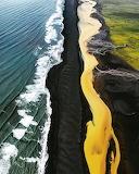 In Iceland, Black Beach,Yellow River, Blue Sea, meet