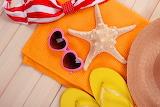 Sunglasses, hat, starfish, towel, bag, flip-flops