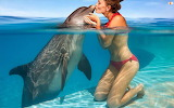 girl kissing dolphin