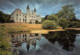 Abandoned baron palace on pond