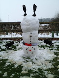 Snowman was built upside down - but he still has his scarf, glov