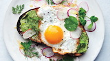 Fried-egg-on-toast-with-salted-herb-butter-and-radishes