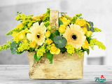 ^ Yellow flowers in a wooden basket
