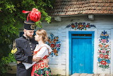 Couple, love, traditional costume, uniform, decorated house, blu