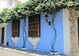 ^ Colorful colonial houses at the walled city of Cartagena, Colu