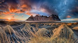 Landscape-Sunset-Sand-Mountains-Dark-Clouds-Iceland