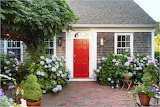 ^ Cape Cod house with red door