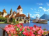 Castle-oberhofen-lovely-lake-dock-flowers-boat-sea