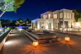 luxury modern villa at night in ibiza