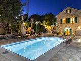 Beautiful rustic villa and pool at night