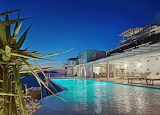 Luxury seaview villa and pool at night, Mykonos