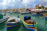 Fishing boats at Maraxlokk port Malta