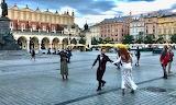 Poland, Krakow, Old Town, bride & groom dancing in Main Market S