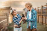 couple with little pig
