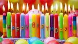 Tapeciarniapl231460 swieczki kolorowe urodziny