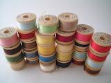 ^ Vintage yarn spools