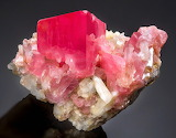 "Science tumblr hematitehearts ""Rhodochrosite sitting atop Quartz"