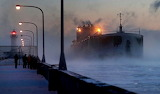 Sea smoke rises on Lake Superior ship St. Clair comes to harbor