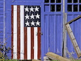 ^ Stars and stripes on blue barn