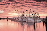 Red skies over shrimp boats