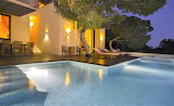 Illuminated villa, pool and terrace at night