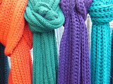 ^ Knitted scarves