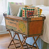 Banana box with quilts and pillows