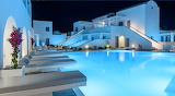 Luxury pool and spa in Santorini at night