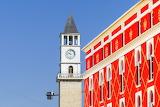 Red-building-windows-bell tower-clock-Tirana