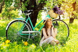 Girl relaxes during a trip in the park by bike