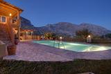 Mediterranean mountain view villa, pool and garden at night