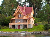 Cottage red roof by lake