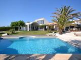 Luxury minimalist white villa, garden and pool
