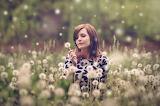 Woman-sitting-in-a-field-of-flowers-157604
