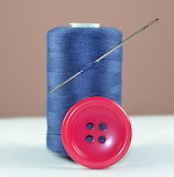 ^ Button, needle and thread