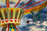 Carousel-seats-sky-clouds