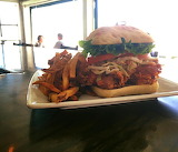 ^ Fried chicken on ciabatta, candied hot sauce, lettuce, tomato,