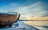 Stern of boat pulled onto beach at Blue Hour Baltic Sea