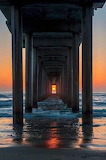 Sunset through a pier