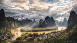 Sun breaking through clouds Li River China