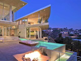 Luxury white modern hillside mansion and pool